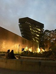 0f0e32d1c2e7 The De Young Museum photographed on a foggy night in 2015.