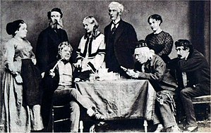 Henry James Byron - 1868 production of Dearer Than Life showing seated l. to r. Toole, Lionel Brough and Irving