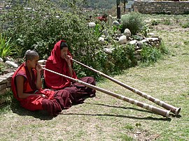 Monks playing dungchen, Dechen Phodrang monastic school, Thimphu