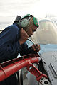 Defense.gov News Photo 110614-N-GO535-970 - U.S. Navy Petty Officer 3rd Class Yusuf Martin assigned to Fighter Squadron Composite 12 completes maintenance on the in-flight refueling probe.jpg