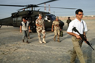 Delta Force - Delta Force bodyguards in civilian clothing providing close protection to General Norman Schwarzkopf during the Persian Gulf War, 1991.