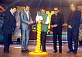 Devendra Fadnavis and the Minister of State for Information & Broadcasting, Col. Rajyavardhan Singh Rathore lighting the lamp to inaugurate the 14th edition of Mumbai International Film Festival – 2016, in Mumbai.jpg
