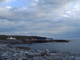 Doolin - Evening at Doolin Harbour, with the Cliffs of Moher and Hag's Head visible in the distance