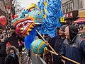 Dragon dance meets bird at NYC Lunar New Year parade (52336)e.jpg
