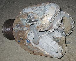 Drill bit tricone worn.jpg