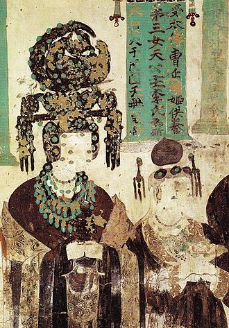 Heqin - A daughter of the King of Khotan married to the ruler of Dunhuang, Cao Yanlu, is here shown wearing elaborate headdress decorated with jade pieces. Mural in Mogao Cave 61, Five Dynasties.
