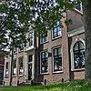 foto van Groot herenhuis met verdieping en schilddak