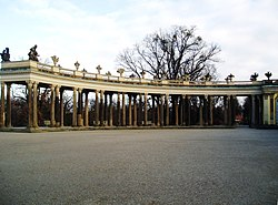 One of the two segmented colonnades enclosing the cour d'honneur on the northern side of the palace.