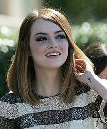 A picture of Emma Stone as she smiles away from the camera.