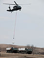 FEMA - 40766 - North Dakota National Guard Black Hawk picks up one ton sand bags.jpg