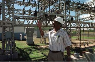 Hurricane Georges - Director of the Virgin Islands Water and Power Authority showing the islands' improved power grid structures