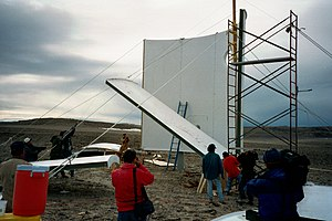 Flashline Mars Arctic Research Station - Volunteers use a scaffold to erect the walls of the station on July 21, 2000.