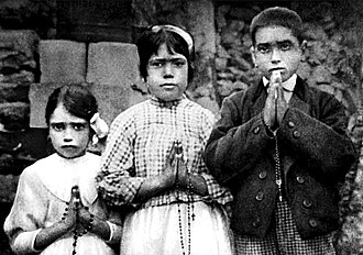 Francisco and Jacinta Marto - From left to right: Jacinta Marto, Lúcia dos Santos and Francisco Marto, holding their rosaries in 1917