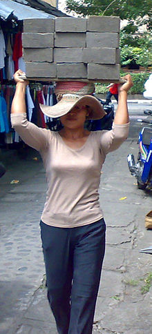 Female laborer transporting concrete blocks in Bali-cropped.jpeg