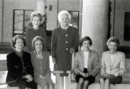 First Ladies Nancy Reagan, Barbara Bush (standing, left to right), Lady Bird Johnson, Pat Nixon, Rosalynn Carter, and Betty Ford (seated, left to right) at the dedication of the Ronald Reagan Presidential Library, November 1991 First Ladies at Ronald Reagan Presidential Library.jpg