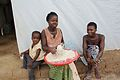 Flickr - DFID - UK Department for International Development - A family making supper, in a refugee camp in Liberia.jpg