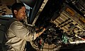 Flickr - Official U.S. Navy Imagery - Sailor takes apart jet engine..jpg
