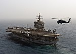 Flickr - Official U.S. Navy Imagery - The incoming CO of the Dragonslayers flies past USS Enterprise during an airborne change of command ceremony..jpg