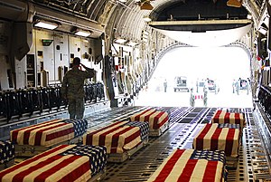 Aftermath of the September 11 attacks - Coffins of soldiers killed in the 2009 Fort Hood shooting being loaded aboard an aircraft for flight to Dover Air Force Base