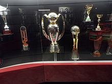 Benfica's third League and League Cup double (centre)