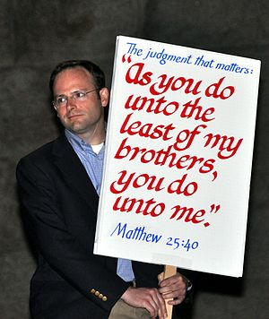 Religion and capital punishment - Jonathan Kendall protesting against capital punishment in Utah, holding a sign citing Matthew 25:40.