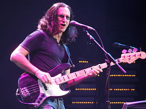 Geddy Lee - Lee playing his Fender Jazz Bass and singing at a 2008 live performance at the Xcel Energy Center