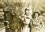 George and Barbara Bush with their children, George and Robin.jpg