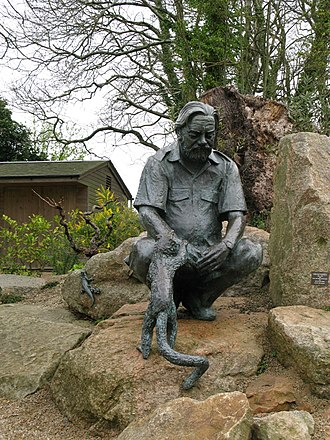 Jersey Zoo - Statue of Gerald Durrell with a black-and-white ruffed lemur, April 2008