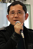A photograph of Shu Takumi