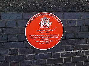 James W. Gibson - A plaque on Sir Matt Busby Way commemorating Gibson's work as chairman of Manchester United from 1931 to 1951.