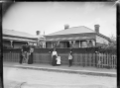 Godber family outside their house, Railway Whare, at 23 Bay Street, Petone ATLIB 141448.png