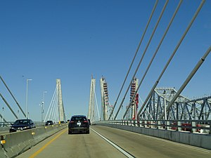 Goethals Bridge - Traveling west over the new eastbound span in 2017, with the westbound span under construction at near right and the original span at far right