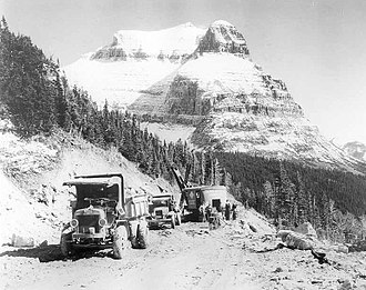 Glacier National Park (U.S.) - Road construction along the Going-to-the-Sun Road with Going-to-the-Sun Mountain in the background, 1932