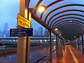 HK Central Pier 9 to 10 covered path walkway night signs Oct-2012.JPG