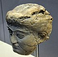 Head of a female worshiper, from the Temple of Ishtar at Nineveh, Iraq. 700-625 BCE. British Museum.jpg