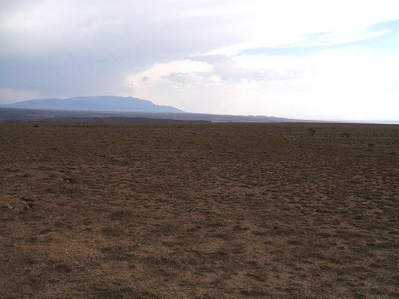 File:Heavily Grazed Land East of Interstate 25, Sandia Range on the Horizon - panoramio.jpg