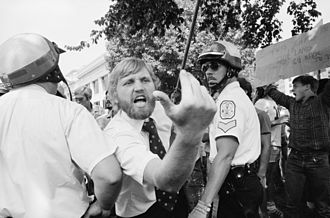 Heckler - A heckler in Washington, D.C. leans across a police line toward a demonstration of Iranians during the Iran hostage crisis, August 1980.