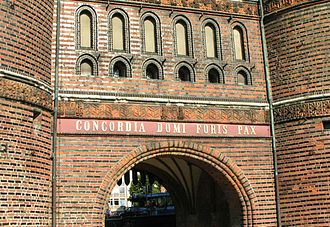 Holstentor -  Inscription on the field side of the Holsten Gate: CONCORDIA DOMI FORIS PAX