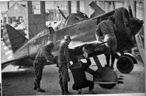 Soviet Volunteer Group - Japanese aircraft engineers examine a captured Soviet I-16 fighter.