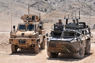 Véhicule de l'Avant Blindé - VAB deployed with the French contingent of the ISAF (right), next to a US MRAP, 7 August 2009.