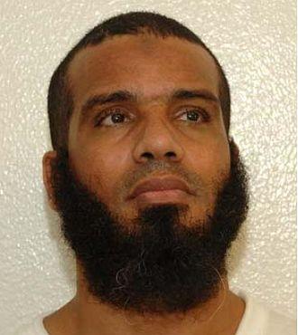 Hisham Bin Al Bin Amor Sliti - Hisham Sliti's Guantanamo identity portrait, showing him wearing a white uniform issued to compliant individuals