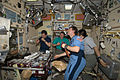 ISS-20 Crew members share a meal at the galley in the Zvezda Service Module.jpg