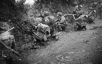 44th Infantry Brigade (United Kingdom) - Infantrymen of the 6th Battalion, Royal Scots Fusiliers in action in a sunken lane during Operation 'Epsom', Normandy, 26 June 1944.