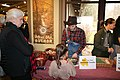 Intern Zack Curtis and Ranger Katie Corrigan assist visitors in making beeswax candles at the 2018 Festival of Christmas Past, December 8, 2018--Warren Bielenberg (46080027605).jpg