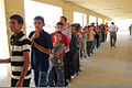 Iraqi school children stand in line to receive school supplies in Sudaryr, Iraq, Oct 111005-A-PQ424-001.jpg