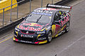 Jamie Whincup in Red Bull Racing Australia car 1, departing pitlane during the V8 Supercars Test Day.jpg