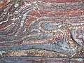 Jaspilite banded iron formation (Soudan Iron-Formation, Neoarchean, ~2.69 Ga; Stuntz Bay Road outcrop, Soudan Underground State Park, Soudan, Minnesota, USA) 35 (19038056500).jpg