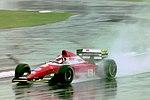 Jean Alesi - Ferrari F193 during practice for the 1993 British Grand Prix (33686706485).jpg
