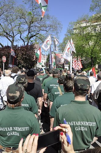 Jobbik - Members of the New Hungarian Guard stand at a Jobbik rally against a gathering of the World Jewish Congress in Budapest, 4 May 2013