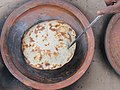 Kalai Ruti baking beside Shyama Sarobar, Puthia (01).jpg